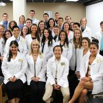 Doctor of Physical Therapy students don their white coats.