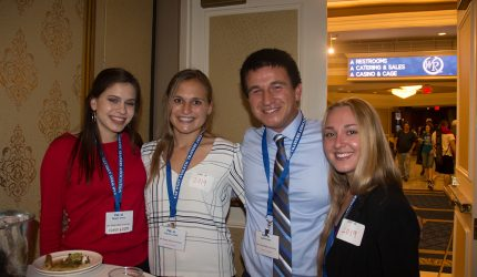 Students Smiling at Conference