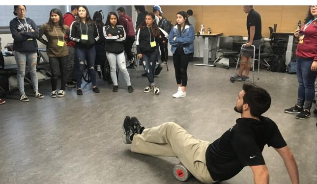 Students learning how to use PT equipment