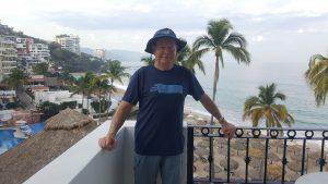 Bob Larson standing at the beach
