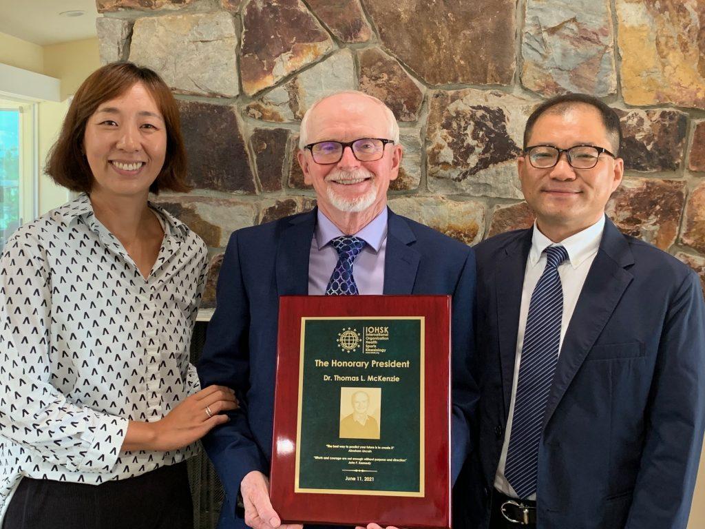 Dr. McKensie receiving award